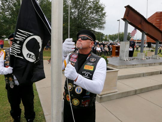 Joe McEwen III, with Rolling Thunder Chapter Tennessee 1, raises the POW flag during a 9/11 Ceremony at the Rutherford County Sheriff's Office on Monday, Sept. 11, 2017.