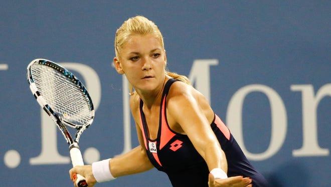 Agnieszka Radwanska (POL) returns a shot to Ekaterina Makarova (RUS) on Armstrong Stadium on day seven of the 2013 US Open at the Billie Jean King National Tennis Center.