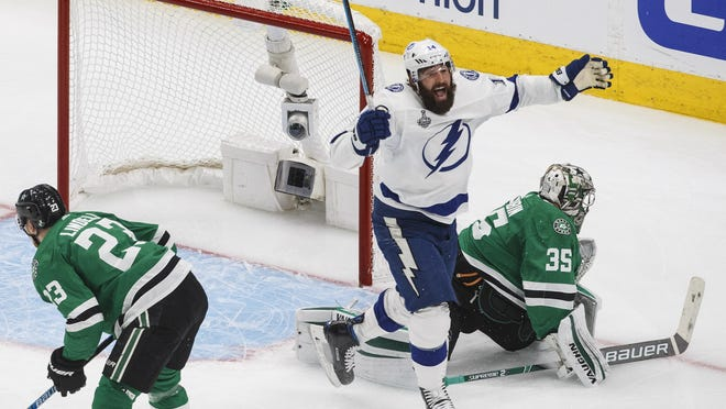 Tampa Bay Lightning's Pat Maroon (14) reacts as the puck goes in past Dallas Stars' goalie Anton Khudobin (35) on a shot from Lightning's Blake Coleman (not shown) during second period of Game 6 of the Stanley Cup finals in Edmonton, Alberta.