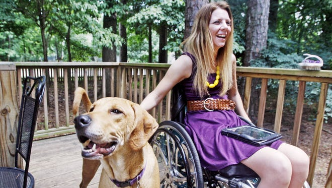 Rachelle Friedman pets her dog Jolly at her home in Knightdale, N.C.