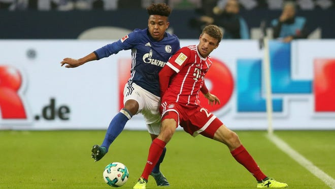 Schalke's Weston McKennie (left) takes on Bayern's Thomas Mueller during the German Bundesliga match  in Gelsenkirchen, Germany.