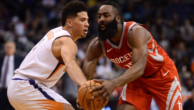 James Harden drives against Phoenix Suns guard Devin Booker during the second half at Talking Stick Resort Arena.