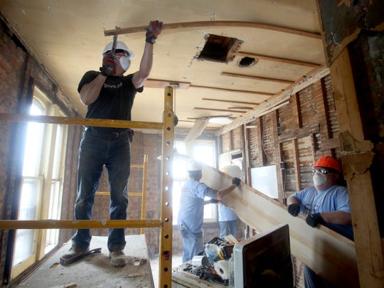 Dan Rossignol of Mahwah, N.J., left, and other volunteers, do demolition work on a home in Haverstraw as the work on a Habitat for Humanity project June 9, 2017. The house, which will take about eight months to renovate, will be sold by Habitat to Humanity to a family with zero interest loan.