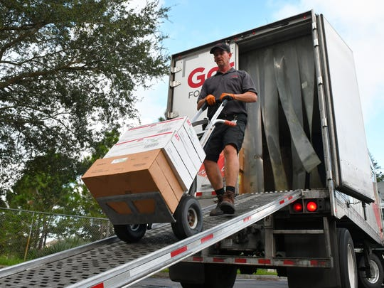 Bobby Goins of Gordon Food Servivce, delivers food for the shelter set up at Imperial Estates Elementary in Titusville on Friday, as residents prepare for Hurricane Irma.