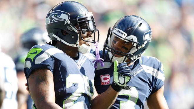 Seahawks RB Marshawn Lynch and QB Russell Wilson  (3) form one of the NFL's top backfields.