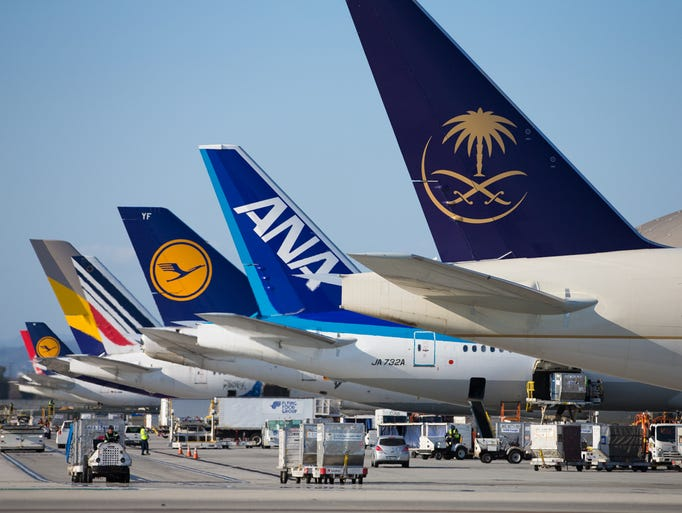 Tails of airlines from across the world are readied