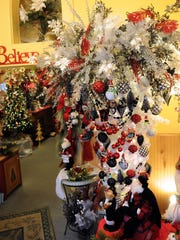 The new trendy upside-down tree such as this black-red decorated white tree is supported on a traditional stand in an inverted presentation providing more room at the base. To see more photos from inside the holiday shop, go to www.doorcountyadvocate.com.