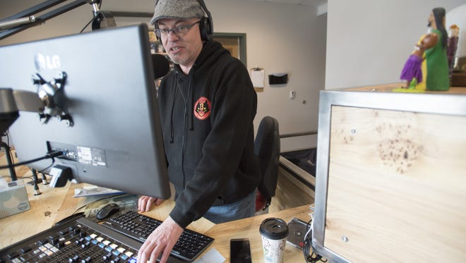 "Jon Bard or ""Brother JB"" goes on air for his show, ""The Wild Ride,"" on KRFC Public Radio on Friday, March 10, 2017. The community radio station has moved into its new home at The Music District on College Avenue."