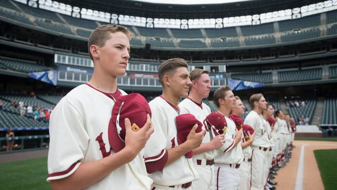 Rocky Mountain High School's baseball team, shown during the playing of the national anthem before a 2017 game at Coors Field, will play its annual game at the home of the Colorado Rockies at 3 p.m. Tuesday against Cherokee Trail.