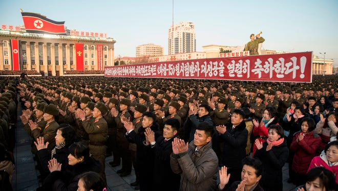 North Koreans attend a mass rally in Kim Il-Sung Square in Pyongyang to celebrate the North's declaration it had achieved full nuclear statehood on Dec. 1, 2017.