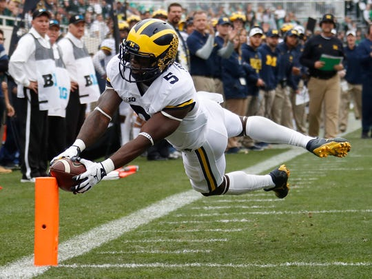 Jabrill Peppers dives for a first-quarter touchdown against Michigan State at Spartan Stadium on Oct. 29, 2016.