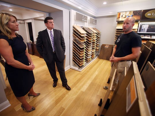 Christine Russell Gray, VP of Commercial Lending at Ocean First Bank and Timothy J. Lizura, President and CEO of New Jersey Economic Development Authority talks with Dan Gorsegner of Gorsegner Brothers Hardwood Floors showing off their new building that it bought through a New Jersey Economic Development Authority program. July 19, 2017. Holmdel, NJ