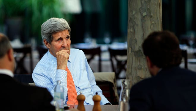 U.S. Secretary of State John Kerry, center, National Security Council point person on the Middle East Robert Malley, left, and Chief of Staff at the U.S. Department of State Jon Finer meet on the terrace of a hotel where the Iran nuclear talks meetings are being held in Vienna, Austria, Thursday, July 2, 2015.  (Carlos Barria/Pool via AP) ORG XMIT: WX159