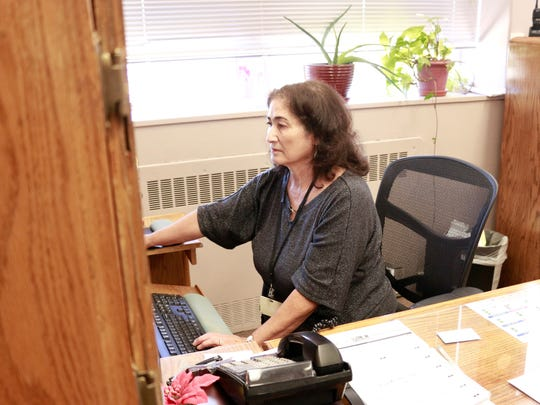 Frances Tweed, registered nurse and administrator of the New Mexico Behavioral Health Institute, works in her office on Oct. 16, 2017 in Las Vegas. Tweed oversees the institute's five divisions.