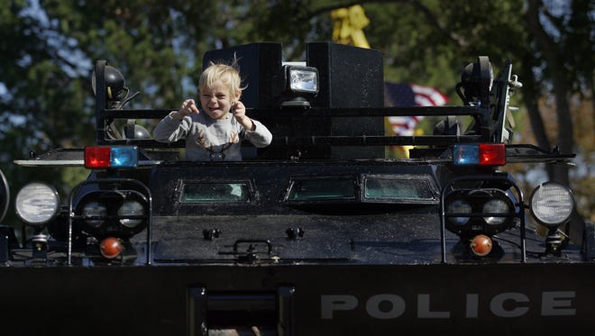 Canon Bower stands on top of a SWAT vehicle during the fourth annual Touch-a-Truck family event in Simi Valley on Saturday.