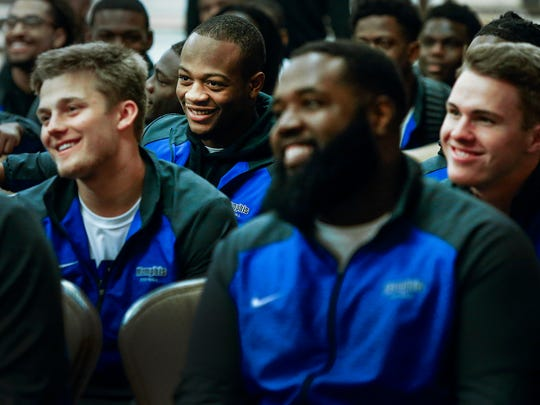 University of Memphis running back Sam Craft (middle)