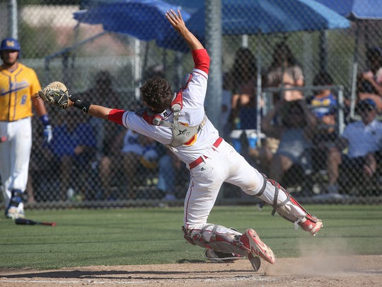 Palm Desert catcher Anthony Boetto catches a pop fly during their win over La Mirada in the second round of the CIF SS baseball playoffs in Palm Desert, May 23, 2017.