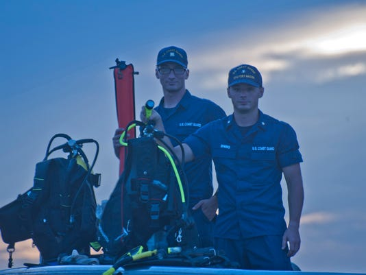 Their boat was gone as darkness fell. But two lost divers had a flashlight -- and buddies