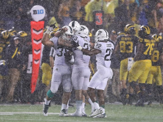 10894a694a8 The Spartans' 14-10 win last season in Ann Arbor was their eighth win in 10  years in the MSU-Michigan rivalry. (Photo: Leon Halip, Getty Images)