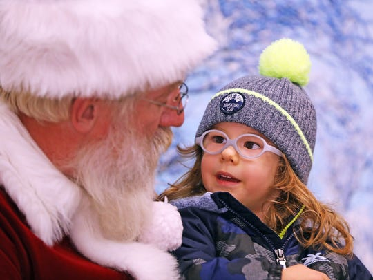 Edward Mrowka, 2, of Urbandale, Iowa, talks with Santa.