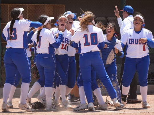 Las Cruces High School Bulldawgs celebrate a win during May 2018 state softball championship finals in Albuquerque. In 2019, softball finals will coincide with Las Cruces Public Schools graduation dates.