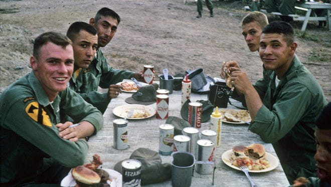 Members of the 1st Cavalry Division enjoy a meal of burgers and Coca-Cola in Vietnam in 1965, items that were not available in the field but served at barracks. The photo was donated to the Wisconsin Veterans Museum by Ted T. Boquist of Redgranite who was sent to Vietnam in 1965 with the 1st Cavalry and was attached to the 82nd Airborne when he returned to the U.S.