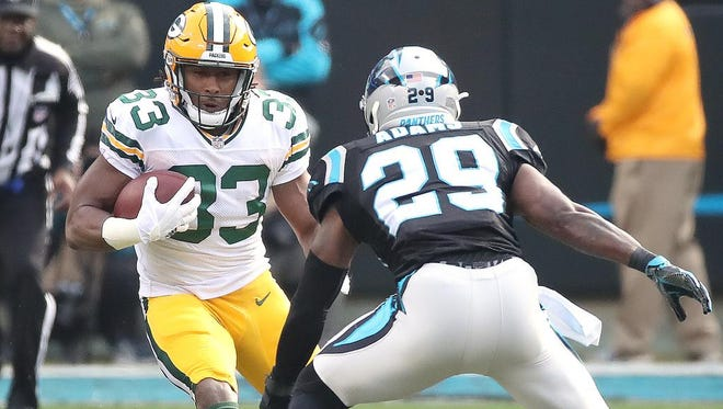 Green Bay Packers running back Aaron Jones (33) gains yards on a run against the Carolina Panthers on Sunday, Dec. 17, 2017 at Bank of America Stadium in Charlotte, N.C.