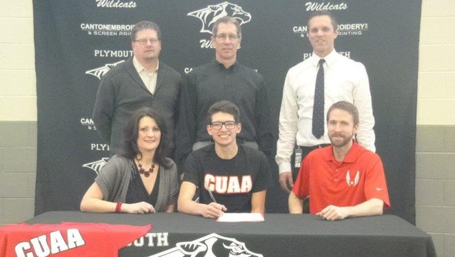 Plymouth senior Nathan Harris, flanked by mom Dana Harris and Concordia track coach Andrew Tirnenstein on National Signing Day. In the back row are his dad, Dave Harris, Plymouth high jump coach Dean Clemons and Plymouth athletic director Kyle Meteyer.