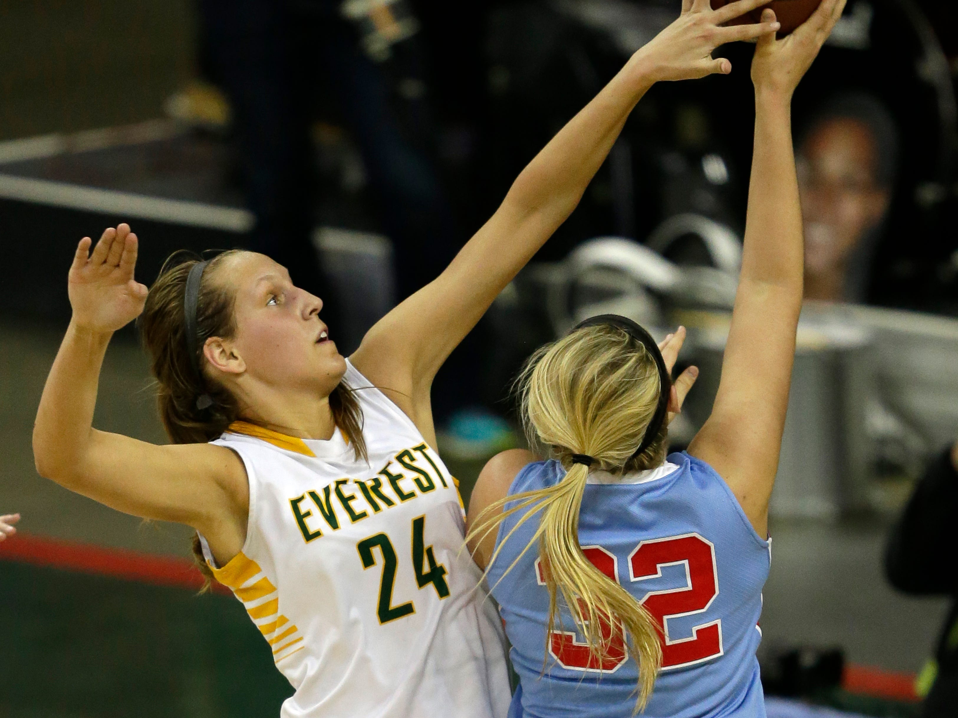 D.C. Everest's Taylor Hodell, left, blocks a shot attempt by Arrowhead's Kayla Lorenz during their WIAA Division 1 state semifinal game last month. Hodell was selected to The Associated Press all-state girls basketball squad Thursday.