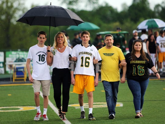 Sycamore senior David Moskowitz [center] with family