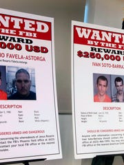 In this July 9, 2012, file photo, with wanted posters