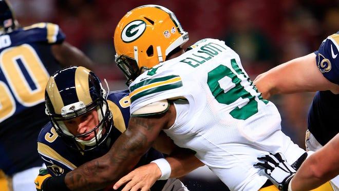 Jayrone Elliott sacks St. Louis Rams quarterback Austin Davis.