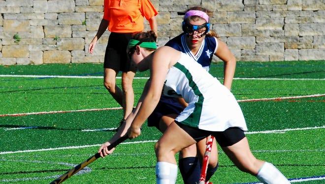 Ursuline's Jillian Shive, front, makes a shot on goal against Mount Notre Dame's Sophie Sikora, back, last season.