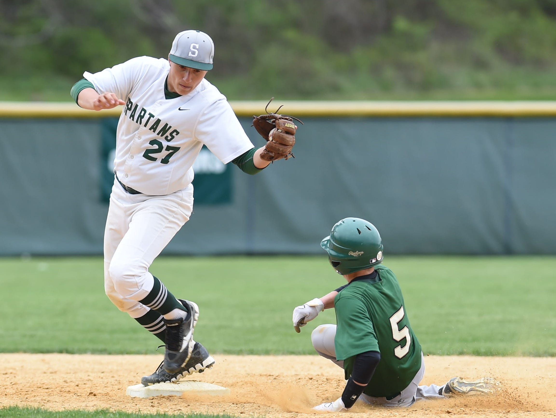 Spackenkill's Mike Hovermill, left, makes the tag at second base as Roosevelt's Mike Santoro, right, slides in during Thursday's game.