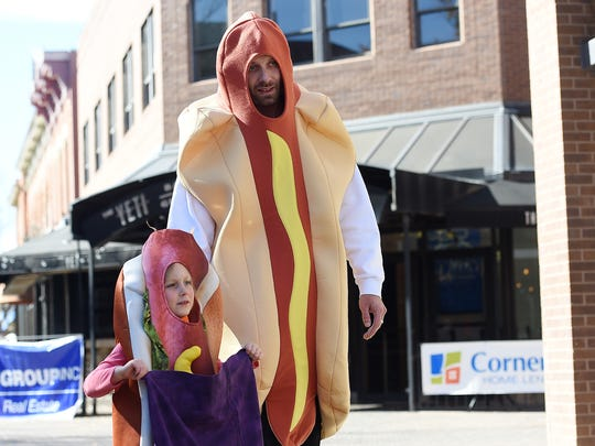 Mike Ward and Story Barbour, 5, sport hot dog costumes at the annual Tiny Tot Halloween in downtown Fort Collins on Monday, October 31, 2016.