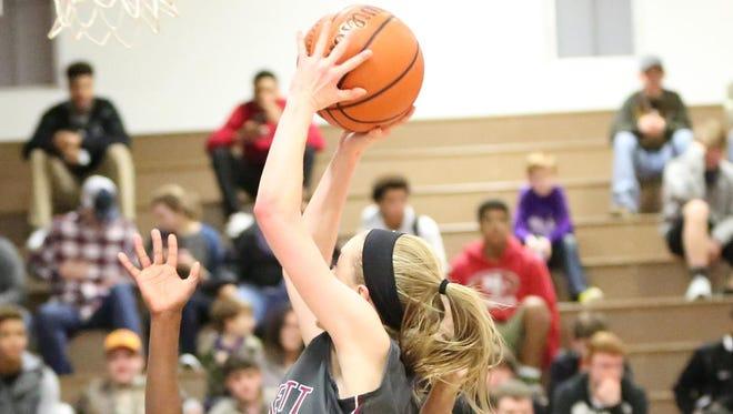 Crockett County's Elli Pratt goes to the basket and draws a foul Thursday at Milan.