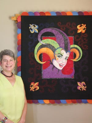 """Pat Kerko, the September Artist of the Month for the North Augusta Artists Guild, designs her own quilts. This fabric art piece, """"Mardi Gras II,"""" has won several first-place awards in both national and regional exhibits."""