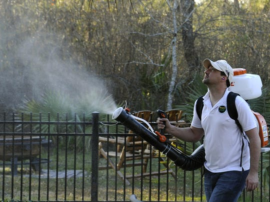Darryl Nevins, owner of a Mosquito Joe franchise, sprays a backyard to control mosquitoes in Houston. The fear is that Zika virus will arrive in the U.S. with the onset of mosquito season.