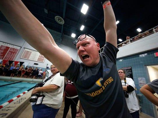 Whitnall High School varsity swimming coach George