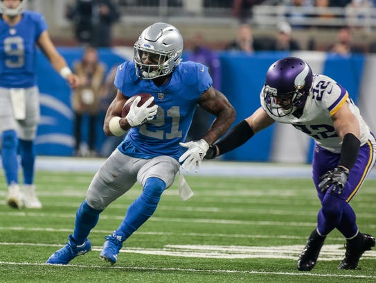 Ameer Abdullah runs past Vikings safety Harrison Smith in the second half.