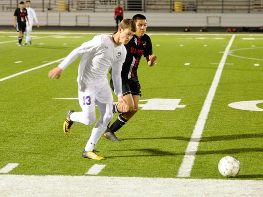 Wylie defender Brazos Ham (13) goes down the sideline