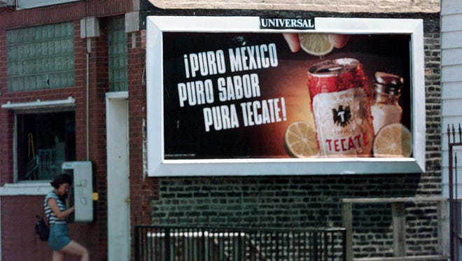 A beer advertisement hangs on the side of a business in Chicago's Pilsen neighborhood on July 26, 1997.