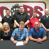 Cheatham County Central High School basketball standout Austin Douglas signed with Bryan College in Dayton in East Tennessee last week. He is pictured with his parents, Tracy and Brandon, and Bryan College coaches Don Rekoske and Bryan Lawhon and CCCHS coaches Aaron Nicholson and Josh Stuart.