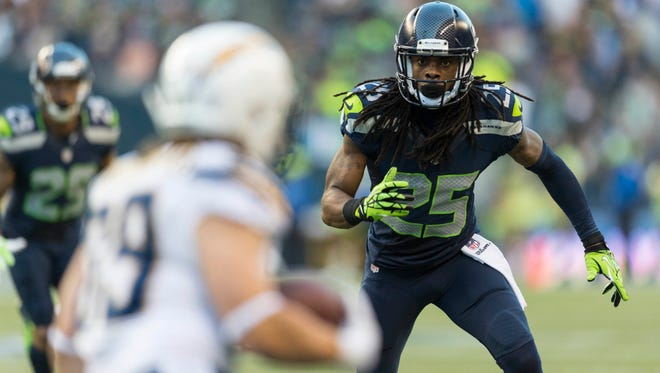 Seattle Seahawks cornerback Richard Sherman (25) covers San Diego Chargers running back Danny Woodhead (39) during the first half at CenturyLink Field in Seattle on Aug. 15, 2014.