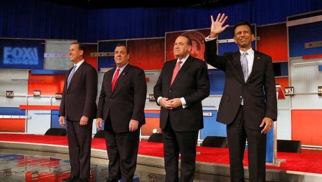 Republican presidential candidates Rick Santorum, Chris Christie, Mike Huckabee and Bobby Jindal take the stage during Republican presidential debate at Milwaukee Theatre, Tuesday, Nov. 10, 2015, in Milwaukee.