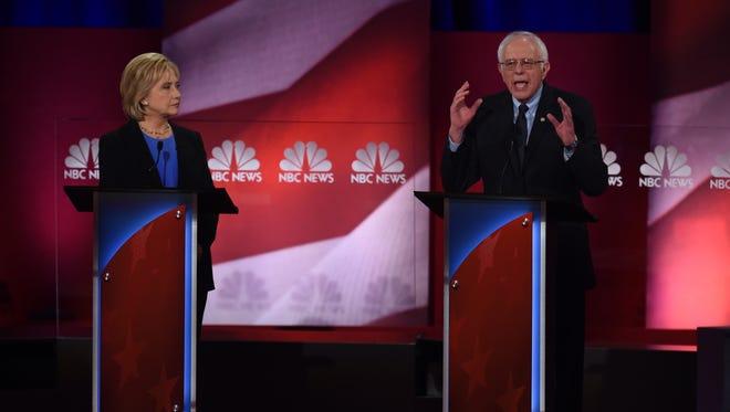 Hillary Clinton and Bernie Sanders participate in the NBC News-YouTube Democratic debate on Jan. 17, 2016, at the Gaillard Center in Charleston, S.C.