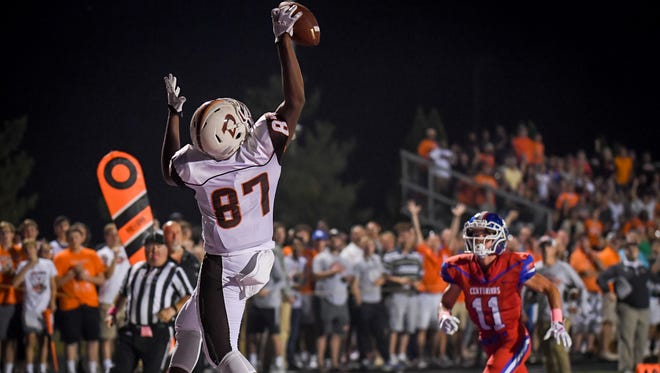 DeSales High School's Demetri Scott makes the one handed catch for a touchdown during the game against Christian Academy of Louisville in Louisville, Friday, Oct. 6, 2017.