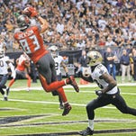 Buccaneers wide receiver Vincent Jackson, left, pulls in a touchdown catch over Saints safety Kenny Phillips on Sunday in New Orleans.