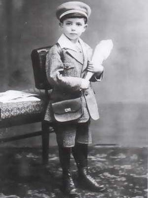 """An unidentified child holding a cone filled with candy, featured in Ann Weiss' book The Last Album: Eyes from the Ashes of Auschwitz-Birkenau."""""""