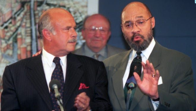 Compuware C.E.O. Peter Karmanos jr., and Mayor Dennis Archer talk about  the Compuware building its corporate headquarters in downtown Detroit at a press conference in the City County Building on April, 9, 1999.